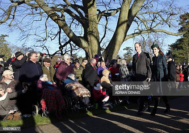Britain's Prince William and his wife Catherine Duchess of Cambridge arrive for a traditional Christmas Day Church Service at Sandringham in eastern...