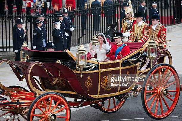 Britain's Prince William and his wife Catherine Duchess of Cambridge leave after their wedding in Westminster Abbey in the 1902 State Landau along...