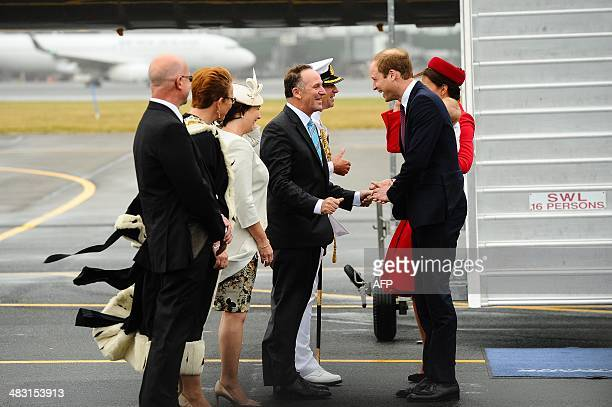 Britain's Prince William and his wife Catherine holding baby Prince George are greeted by New Zealand Prime Minister John Key his wife Bronagh...