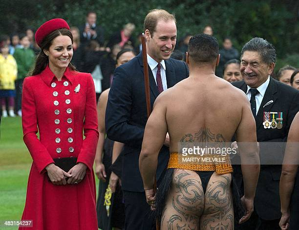 Britain's Prince William and his wife Catherine meet a Maori warrior during a welcoming ceremony at Government House in Wellington on April 7 2014...