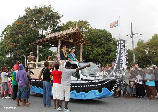 Britain's Prince William and his wife Catherine the Duchess of Cambridge are greeted by the local Solomon Islanders aboard a truck decorated as a...