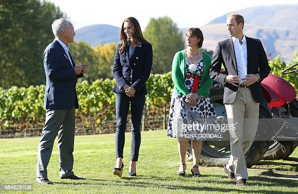 Britain's Prince William and his wife Catherine the Duchess of Cambridge chat to John Darby coowner of the Amisfield Winery and Lucie Lawrence chair...
