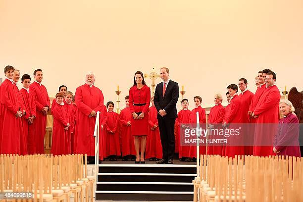 Britain's Prince William and his wife Catherine the Duchess of Cambridge pose with members of the Christchurch Cathedral choir during visit to the...