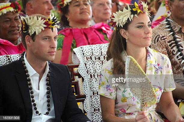 Britain's Prince William and his wife Catherine the Duchess of Cambridge seated at a ceremony to mark their farewell from Tuvalu in the Vaiaku...