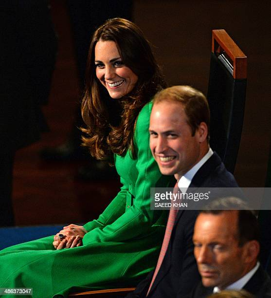 Britain's Prince William and his wife Catherine, the Duchess of Cambridge , smile during a speech by Australia's opposition leader Bill Shorten at a...