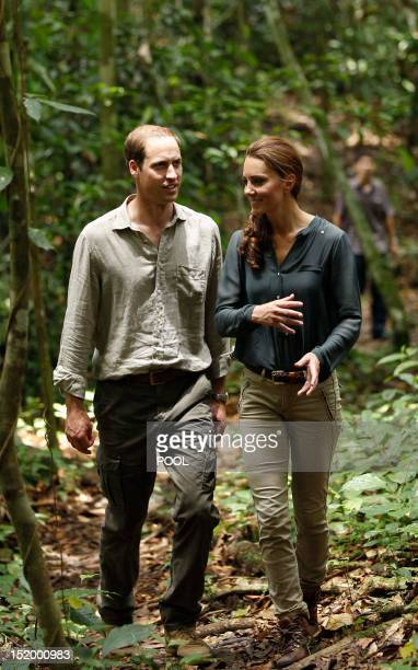 Britain's Prince William and his wife Catherine, the Duchess of Cambridge, walk through the rainforest in Danum Valley Research Center in Danum...