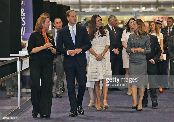 Britain's Prince William and his wife Catherine the Duchess of Cambridge walk through the arts and craft pavilion during a visit to the Royal Easter...