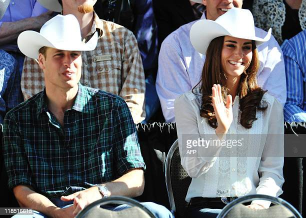 Britain's Prince William and his wife Catherine the Duchess of Cambridge watch entertainers during the Calgary Stampede parade in Calgary Alberta...