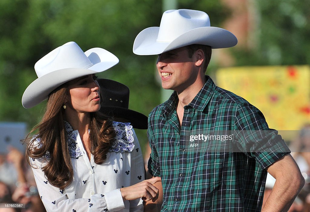 Britain's Prince William and his wife Catherine, the Duchess of Cambridge, watch a rodeo demonstration at the BMO Centre in Calgary, Alberta, July 7, 2011. AFP PHOTO / Don MacKinnon