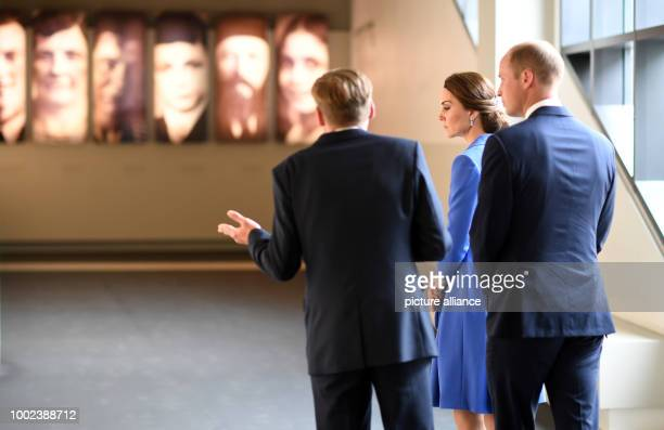 Britain's Prince William and his wife CatherineDuchess of Cambridge visit the museum of the Holocaust Memorial inBerlinGermany 19 July 2017 Photo...