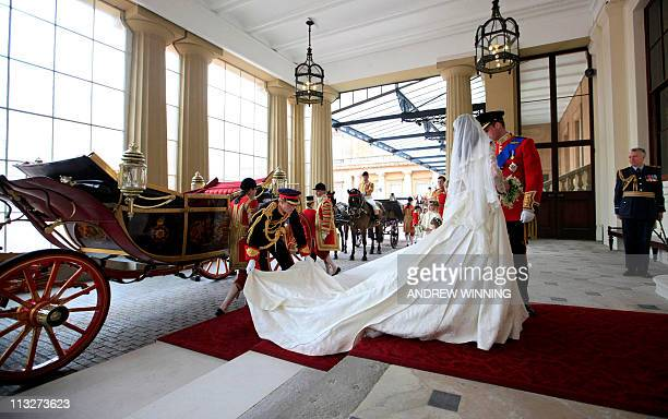 Britain's Prince William and his wife Kate Duchess of Cambridge leave the 1902 State Landau as they arrive at Buckingham Palace after their wedding...