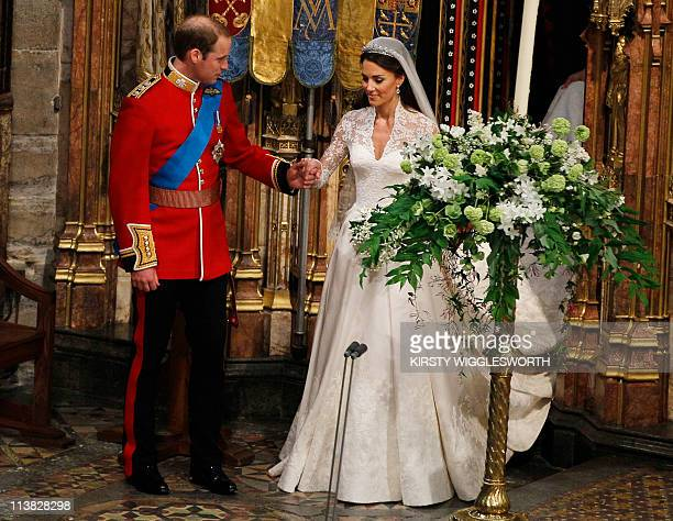Britain's Prince William and his wife Kate Duchess of Cambridge leave Westminster Abbey after the wedding service in central London on April 29 2011...