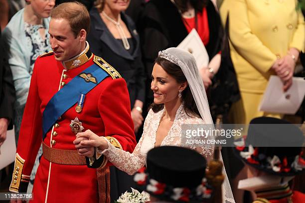 Britain's Prince William and his wife Kate, Duchess of Cambridge, make their way out of Westminster Abbey in London, following their wedding...