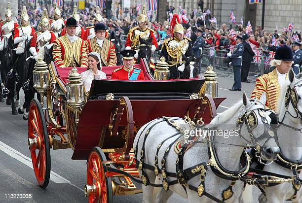 Britain's Prince William and his wife Kate Duchess of Cambridge travel to Buckingham Palace in the 1902 State Landau along the Procession Route after...