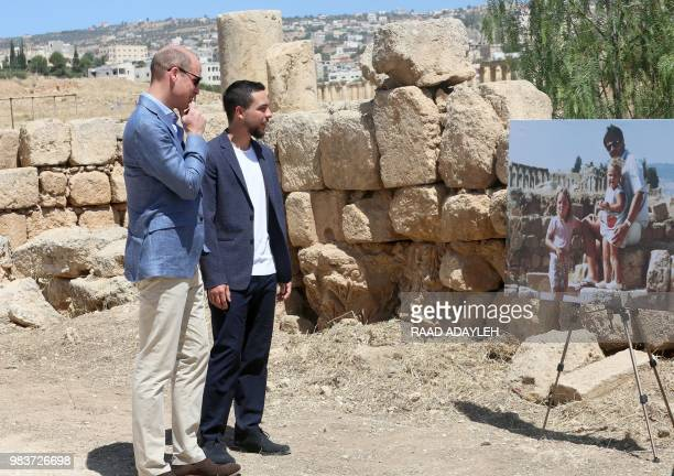 Britains Prince William and Jordanian Crown Prince Hussein bin Abdullah look at an enlarged photograph showing Williams wife the former Kate...