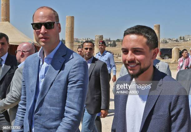 Britain's Prince William and Jordanian Crown Prince Hussein bin Abdullah visit the Jerash archaeological site some 50 kilometers north of the...