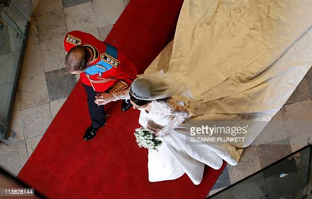 Britain's Prince William and Kate, Duchess of Cambridge, leave Westminster Abbey in london on April 29, 2011 after their wedding ceremony. AFP PHOTO...