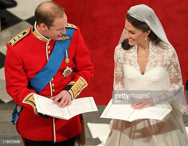 Britain's Prince William and Kate Duchess of Cambridge's exchange vows during their wedding ceremony at Westminster Abbey in London on April 29 2011...