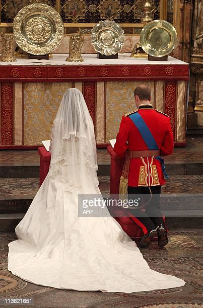 Britain's Prince William and Kate Middleton kneel at the altar of Westminster Abbey in London during their Royal Wedding ceremony on April 29 2011...
