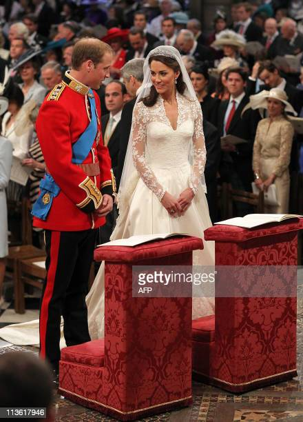 Britain's Prince William and Kate Middleton stand at of Westminster Abbey in London during their Royal Wedding ceremony on April 29 2011 AFP PHOTO /...