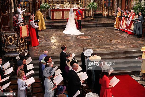 Britain's Prince William and Kate Middleton stand at the altar at Westminster Abbey in London during their Royal Wedding ceremony on April 29 2011...