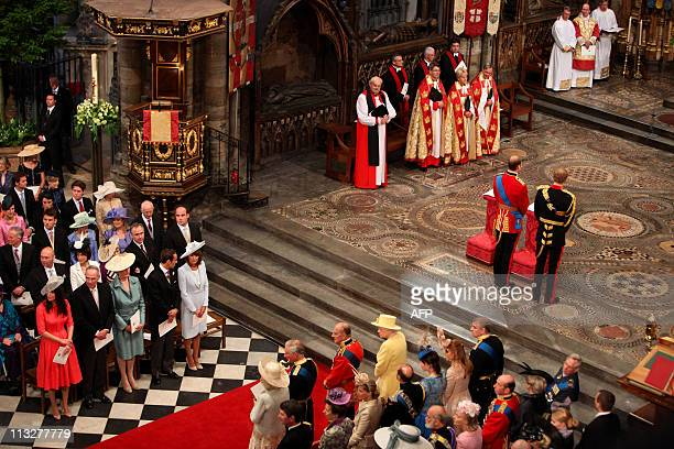 Britain's Prince William and Prince Harry stand in front of the altar during the wedding ceremony at Westminster Abbey on April 29 2011 in London AFP...