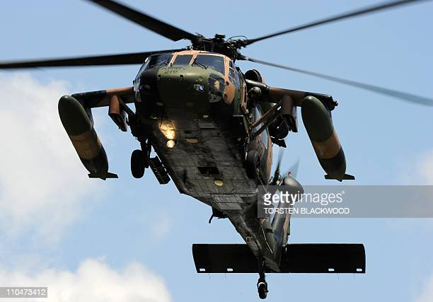 Britain's Prince William and Queensland state Premier Anna Bligh arrive by Australian Army Black Hawk helicopter in the cyclonehit town of Cardwell...