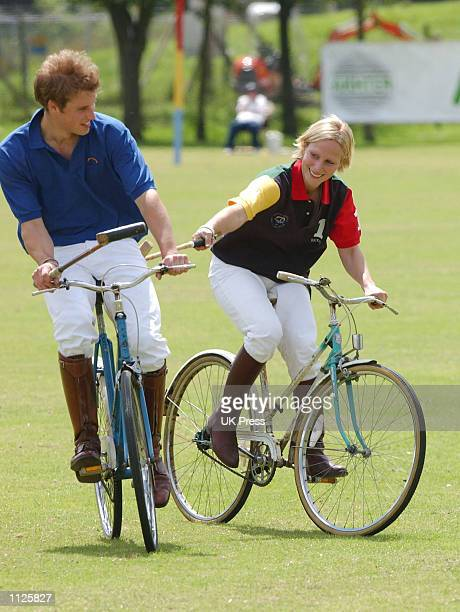 Britain's Prince William and Zara Phillips granddaughter of Queen Elizabeth II participate in the bicycle portion of the Jockeys vs Eventers charity...