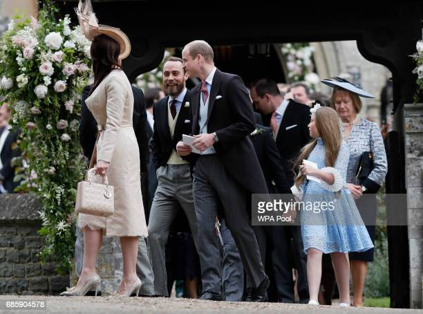 Britain's Prince William center talks to James Middleton after the wedding of Pippa Middleton and James Matthews at St Mark's Church onMay 20 2017 in...