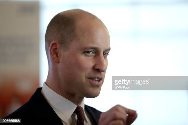 Britain's Prince William chats to guests after delivering a speech at the national launch of a programme to help veterans find work in the NHS hosted...