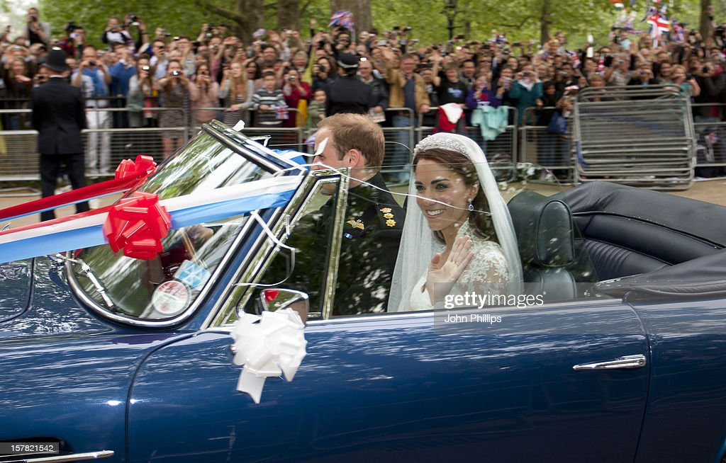 Britain'S Prince William Drives His Wife, Princess Catherine, Duchess Of Cambridge Down The Mall In London, In His Father Prince Charles' Aston Martin Volante Sports Car Covered With Bunting On Their Way To Clarence House.