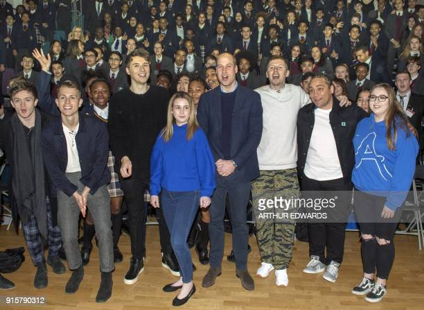 Britain's Prince William Duke of Cambridge accompanied by rapper Stephen Manderson aka Professor Green poses with students taking part in an assembly...