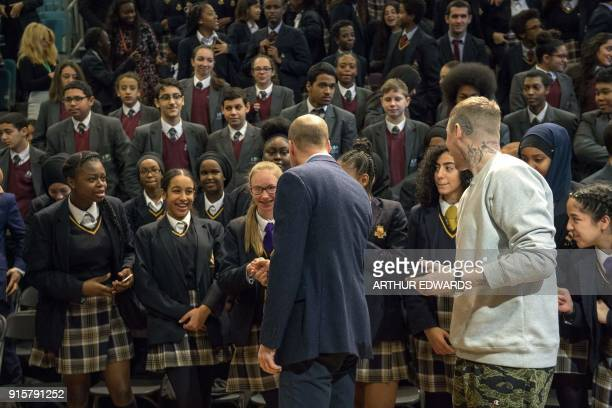 Britain's Prince William Duke of Cambridge accompanied by rapper Stephen Manderson aka Professor Green interacts with students taking part in an...
