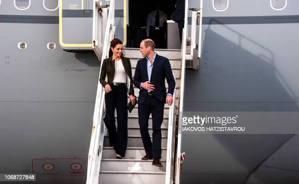 Britain's Prince William Duke of Cambridge and Britain's Catherine Duchess of Cambridge descend from their airplane as they arrive at RAF Akrotiri...