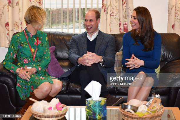 Britain's Prince William, Duke of Cambridge and Britain's Catherine, Duchess of Cambridge speak with helpers during a visit to St Josephs Sure Start...