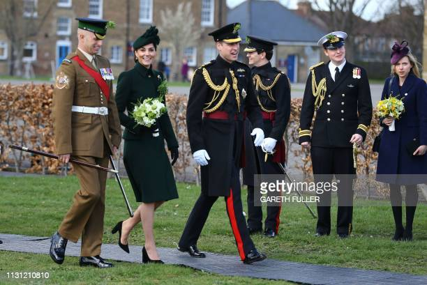 Britain's Prince William Duke of Cambridge and Britain's Catherine Duchess of Cambridge walk amongst the officers and guardsmen of the 1st Battalion...