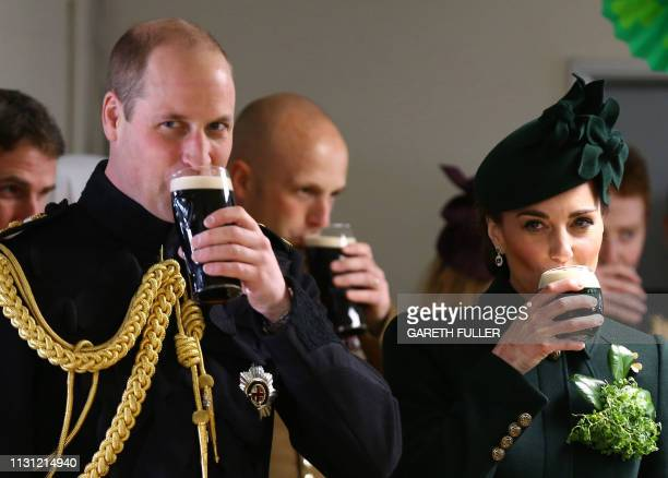 Britain's Prince William Duke of Cambridge and Britain's Catherine Duchess of Cambridge enjoy a pint of Guinness with officers and guardsmen of the...