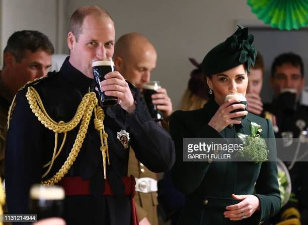 Britain's Prince William, Duke of Cambridge and Britain's Catherine, Duchess of Cambridge enjoy a pint of Guinness with officers and guardsmen of the...