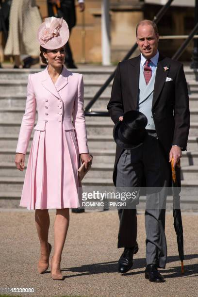 Britain's Prince William, Duke of Cambridge and Britain's Catherine, Duchess of Cambridge attend the Queen's Garden Party at Buckingham Palace in...