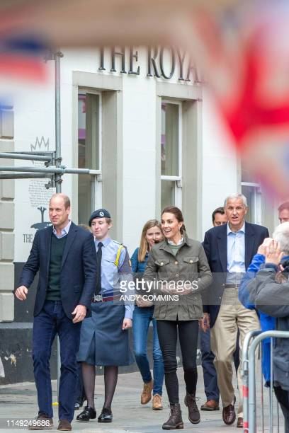 Britain's Prince William Duke of Cambridge and Britain's Catherine Duchess of Cambridge visit the market town of Keswick north west England on June...