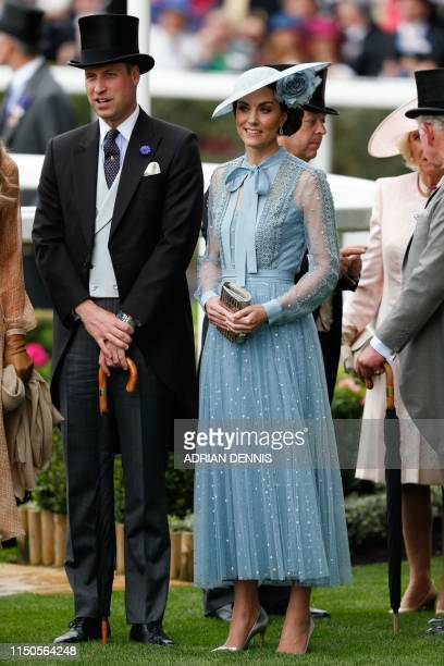 Britain's Prince William Duke of Cambridge and Britain's Catherine Duchess of Cambridge attend on day one of the Royal Ascot horse racing meet in...