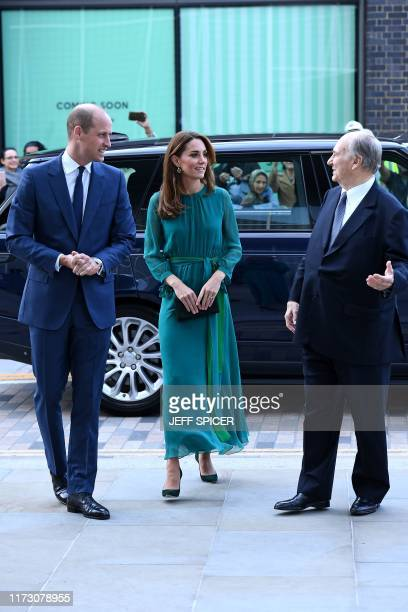 Britain's Prince William Duke of Cambridge and Britain's Catherine Duchess of Cambridge are greeted by Prince Shah Karim Al Hussaini Aga Khan IV on...