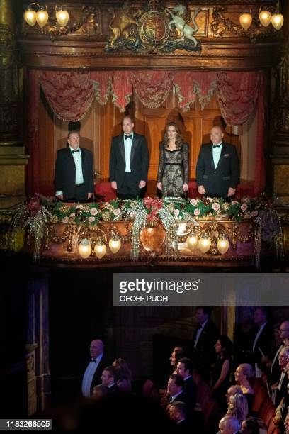 Britain's Prince William, Duke of Cambridge and Britain's Catherine, Duchess of Cambridge stand for the national Anthem in the Royal Box as they...