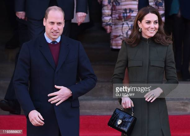 Britain's Prince William, Duke of Cambridge, and Britain's Catherine, Duchess of Cambridge leave after visiting City Hall in Centenary Square,...