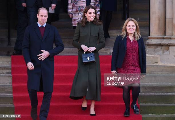 Britain's Prince William Duke of Cambridge and Britain's Catherine Duchess of Cambridge leave after visiting City Hall in Centenary Square Bradford...