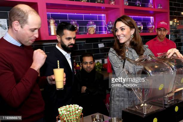 Britain's Prince William Duke of Cambridge and Britain's Catherine Duchess of Cambridge help make glasses of Kulfi lassi during a visit to the...