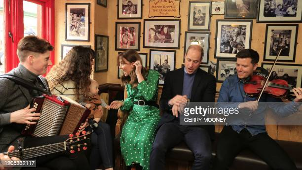 Britain's Prince William, Duke of Cambridge and Britain's Catherine, Duchess of Cambridge visit Galway city centre, western Ireland, on March 5, 2020...