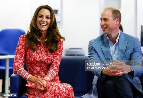 Britain's Prince William, Duke of Cambridge and Britain's Catherine, Duchess of Cambridge speak to people looking for work at the London Bridge...