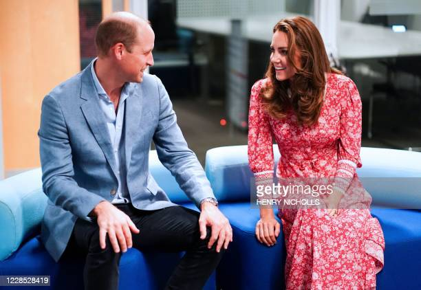Britain's Prince William, Duke of Cambridge , and Britain's Catherine, Duchess of Cambridge chat together as they meet with employers at the London...