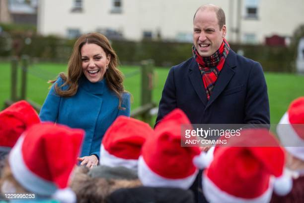 Britain's Prince William, Duke of Cambridge and Britain's Catherine, Duchess of Cambridge meet schoolchildren at Holy Trinity Church of England First...